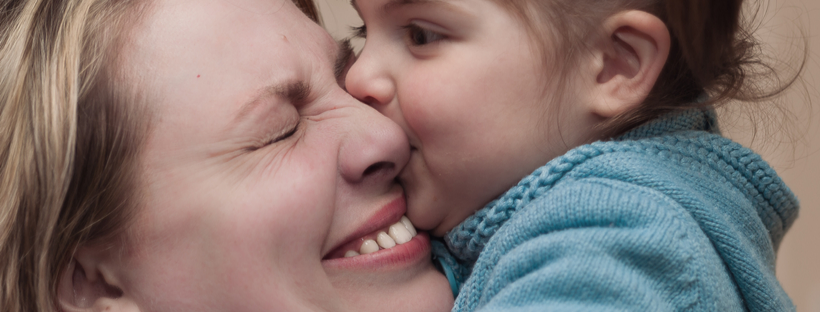 Title banner baby kissing mom