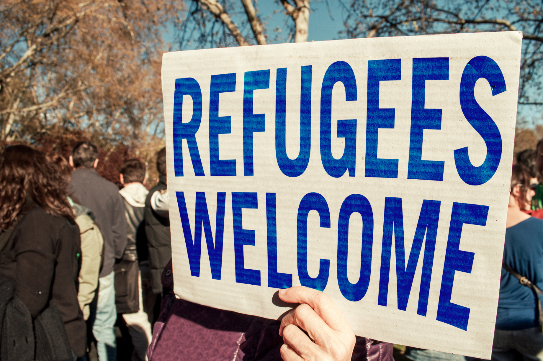 sign that reads refugees welcome